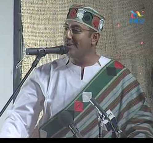 Najib Balala, then ministr for tourism, in sunlight kenya's national dress