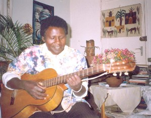 David-G-Maillu-plays-guitar