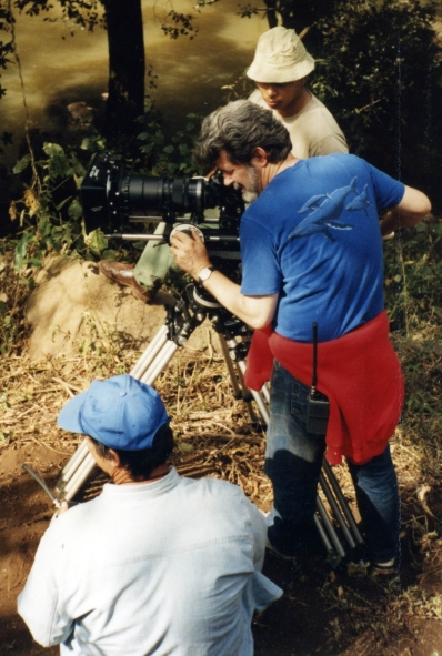 Stan Barua  (in brown hat) assisting George Lucas ( blue T-shirt)