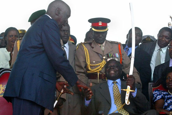 daniel arap moi hands over the Presidency to mwai kibaki  on 30.12.02