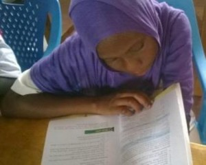 Bishara Mwinyi studying in the new library in Kakuma
