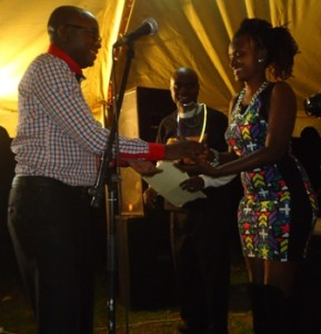 Jean-Marie Ndihokubwayo, co-director, I MASHOKA, receives award for best feature film from grace mbabazi