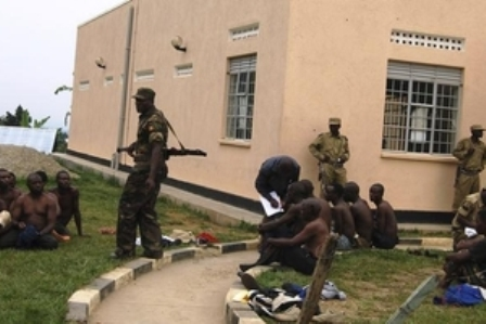 Uganda People's Defence Forces soldiers detain men in Bundibugyo town in Western Uganda, July 6, 2014