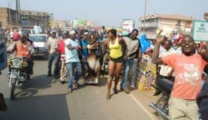 ugandans undressing mini-skirt-clad woman
