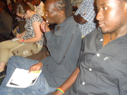 taking notes during monthly Lola Kenya Screen film forum, Nairobi, Kenya