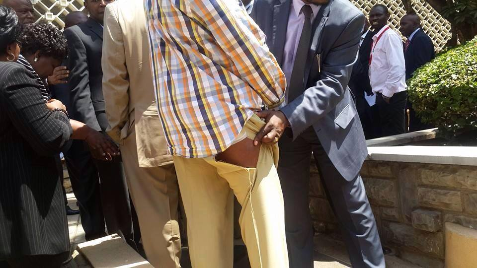 Kenyan Senator Johnstone Muthama shows torn trosers from a brawl in Parliament overcontentious Security Law