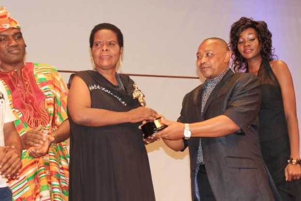 Steven Kanumba's mother receives the Tribute (Personality) Award on the late actor's behalf