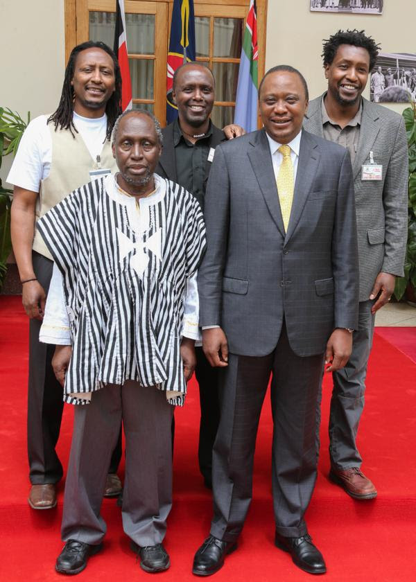Kenyan writer and academic, Ngugi wa Thion'o, and his sons, Mukoma Wa Ngugi, Nducu wa Ngugi and Thiong'o wa Ngugi, with President Uhuru Kenyatta at State House, Nairobi, Kenya