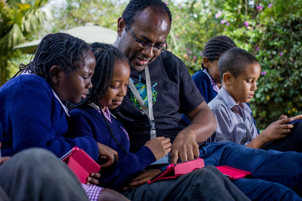 Dr Kommy Weldemariam, Research Scientist,  with pupils from Riara School in Nairobi, Kenya, exploring how technology can help improve educational outcomes