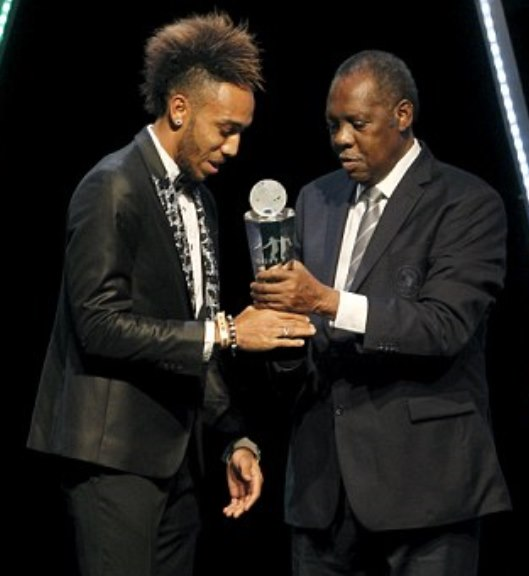 Pierre-Emerick Aubameyang (left) receives the African Footballer of the Year award from Issa Hayatou. a Reuters pic