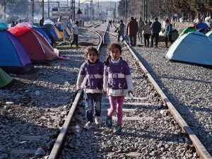 Sisters walk on railway tracks where refugees installed their tents at the makeshift camp of the Greek-Macedonian border near the Greek village of Idomeni. Getty Images pic.