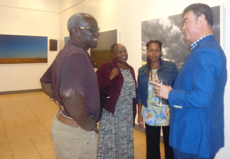 South Korean Oriental Philosophy-guided photographer, Byung Tae Kim, interacts with art lovers during the opening of his exhibition at Nairobi National Museum