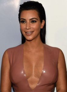 A US American celebrity; reality television personality, actress, socialite, businesswoman and model Kim Kardashian.