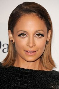 Socialite in her own way as a fashion designer, author, actress and television personality; that's US American Nicole Richie