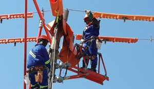 Technicians of Zambia Electricity Supply Corporation spruicing up the national grid