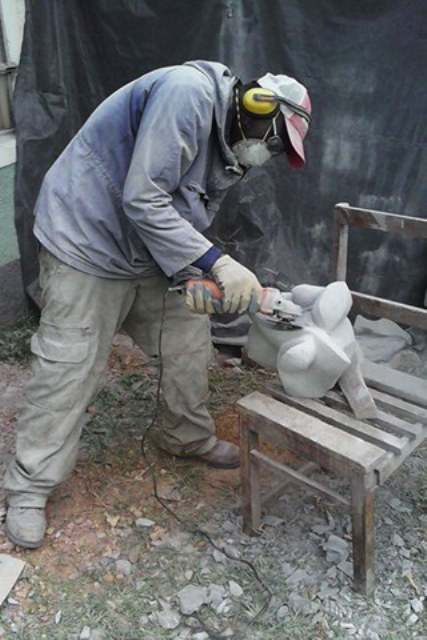 Robin Okeyo Mbera shapes a sculpture in his MberArts premises in Tabaka, Kisii, Kenya
