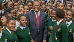 Uhuru Kenyatta, Kenya's President, with students of Alliance Girls High School