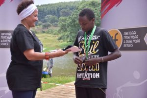 A triathlon winner is presented with awards in 2nd Team Tri Fit (TTF) National Triathlon and Duathlon Challenge in Kericho