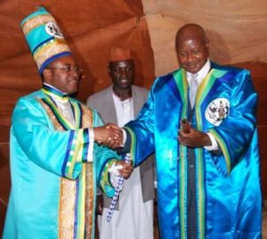 Uganda's President, Yoweri Museveni (right), congratulates Charles Wesley Mumbere Irema-Ngoma (left) at the latter's coronation as King of the Bakonzo.