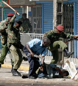 Kenya Police and Administration Police corner and beat up a protester in Nairobi in 2016