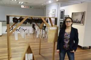 Maral Bolouri of Kenya with the artwork that took the main prize