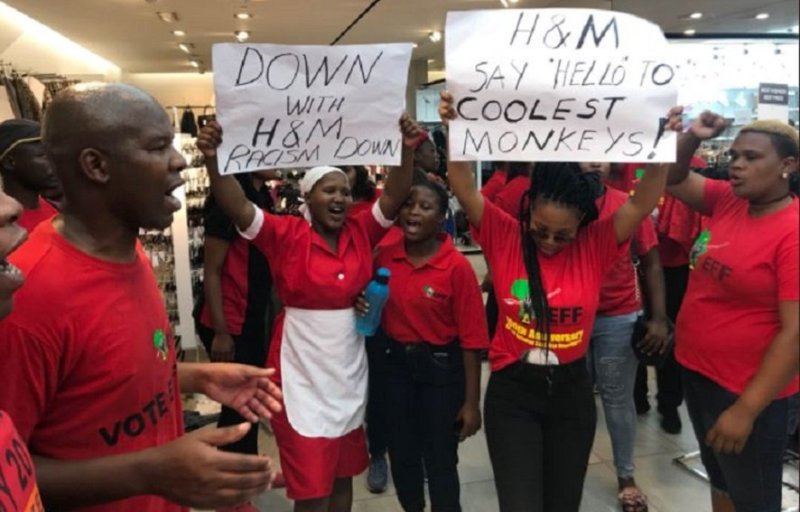 South Africans, led by the Economic Freedom Fighters party, protest in their commercial capital, Johannesburg, against H & M's advert that they interpreted as being racist.