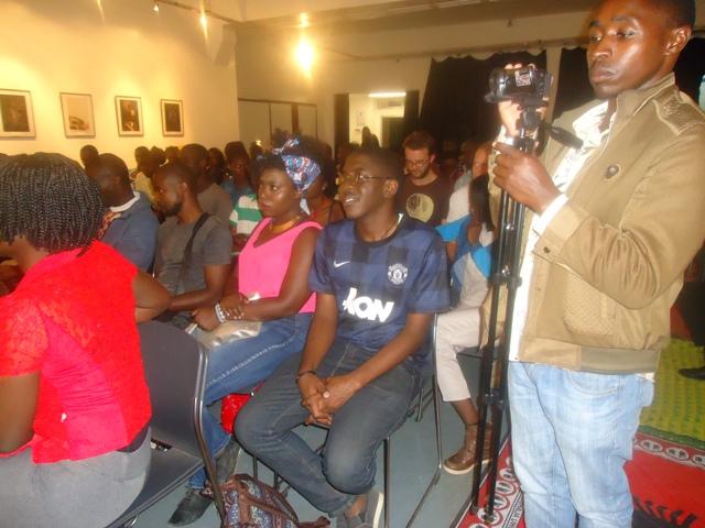 Harun Kiruku Ng'ang'a records proceedings during the 102nd sitting of the bi-monthly Lola Kenya Screen film forum at Goethe-Institut in Nairobi, Kenya on November 27, 2017.