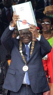 president mwai kibaki declares new constitution in kenya in 2010