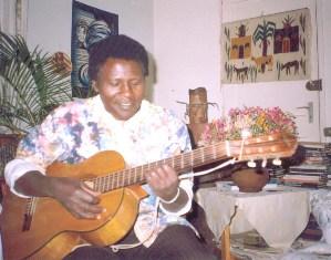 David-G-Maillu-plays-guitar