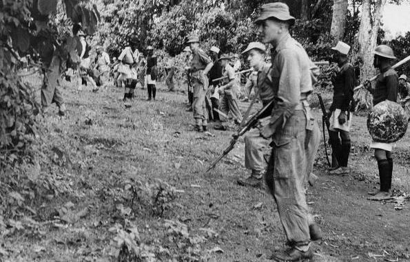 British colonial government tracking down  MAU Mau insurgents