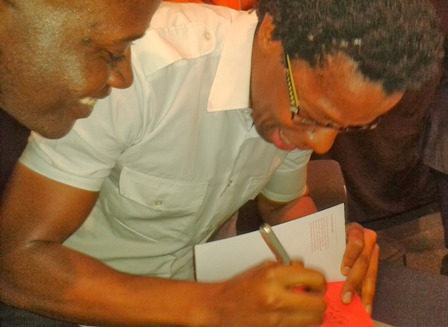 kevin mwachiro signs invisible during the launch in nairobi