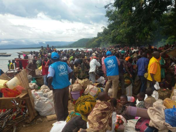 Burundian refugees are received on the shores of Lake Tanganyika in Tanzania. BBC pic rive