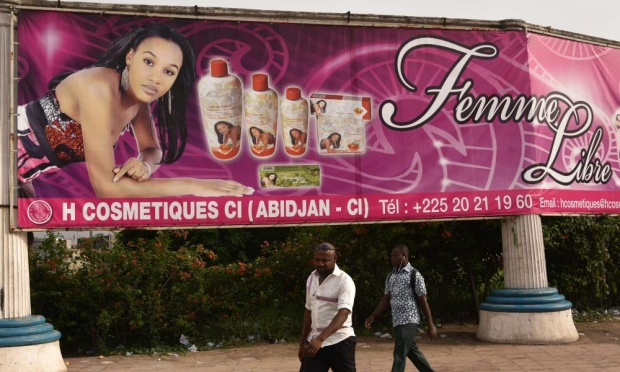 Billboard promoting skin-lightening products in Abidjan, Ivory Coast. AFP pic