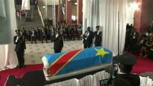 Papa Wemba's casket draped in the colours of the Congolese flag. President Joseph Kabila conferred on Wemba the title of the Grand Officer of the National Order