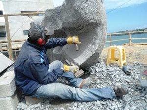Sculptor Robin Okeyo Mbera chisels Granite