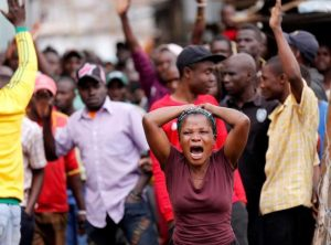 A woman reacts near the dead body of a protester in Mathare, in Nairobi, Kenya August 9, 2017. REUTERS/Thomas Mukoya