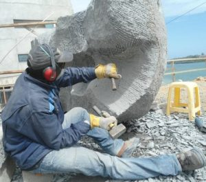 Robin Okeyo Mbera lives off stone and wood sculpting.