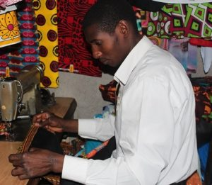 A tailor at work at Kenyatta Market in Nairobi, Kenya.