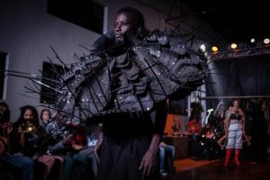 Kefa Oiro dressed in one of the recycled futuristic outfits by the Ugandan fashion designer Xenson (aka Samson Ssenkaaba) in the choreographic fashion concert Chombotrope performed in Kampala. Photo by Esther Mbabazi.