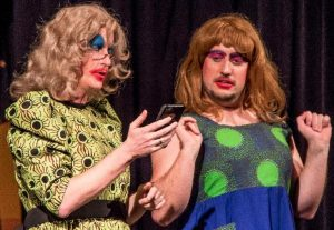 Vinnie Payne as Gladiola and Ben Kramer as Petunia in one of the scenes in Cinderella: If the Shoe Fits play.